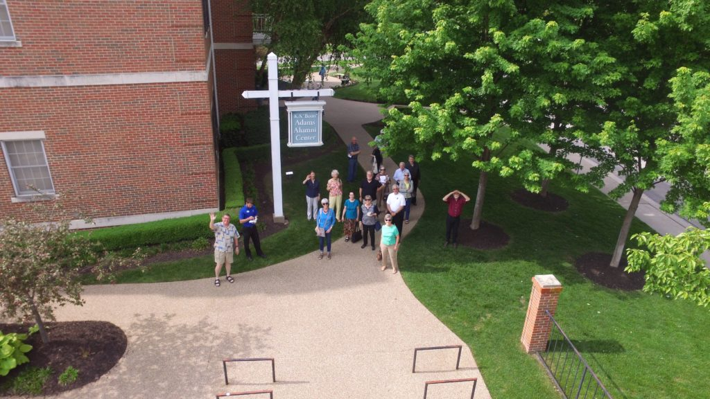 The C&T Studies group watches a drone demonstration outside Adams Alumni Center.